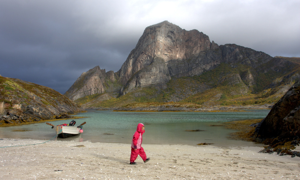 Winston Chen's son, then TK-years-old, walks across a beach on a stormy day. Photo: Winston Chen